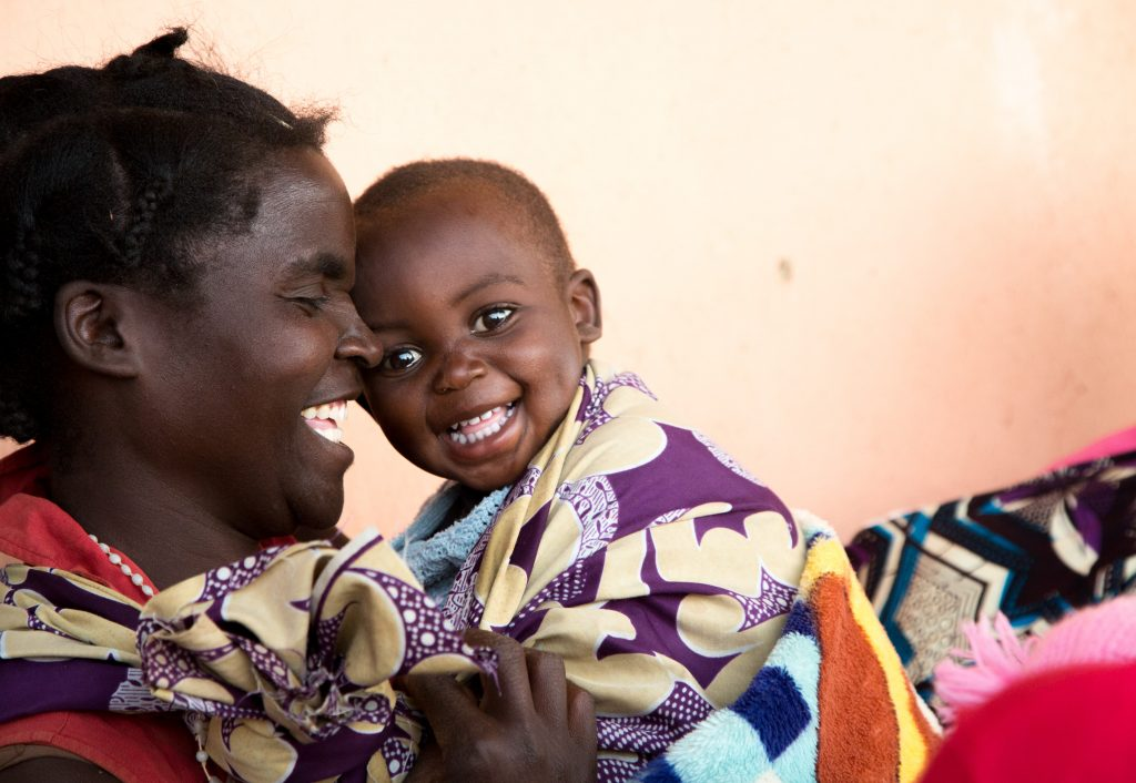 Dcsco Muyanda shares a moment of laughter with her sonBerty.  Dcsco brought her son to the rural health clinic run by Chisekesi Mission Hospital in Chisekesi, Zambia.